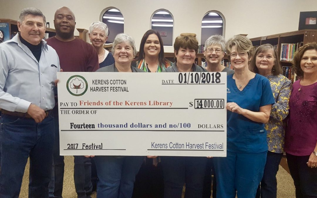 The Kerens Cotton Harvest Festival Committee presented a $14,000 check to the Kerens Library